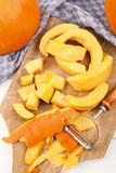 Pumpkin, peeled and cut into small pieces to cook a pumpkin soup Stock Photos