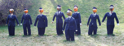 Pumpkin people - businessmen in suits Royalty Free Stock Photo