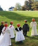 Pumpkin people gathering. Stock Image