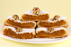Pumpkin Pie. Arrangement of pumpkin pie slices with walnuts Royalty Free Stock Photography