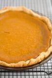 Pumpkin Pie. Fresh Baked Pumpkin Pie on a cooling rack Stock Photography