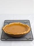 Pumpkin Pie. Fresh Baked Pumpkin Pie on a cooling rack Stock Images