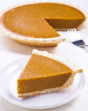 Pumpkin Pie. A Pumpkin pie slice on a table Royalty Free Stock Images