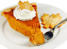 Pumpkin Pie. With whipped cream on a white plate with a fork Royalty Free Stock Image
