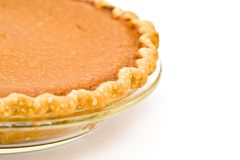 Pumpkin Pie. Home Made Pumpkin Pie fresh from mhy oven - white background Royalty Free Stock Photos