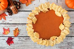 Pumpkin pie above view on white wooden background Royalty Free Stock Image