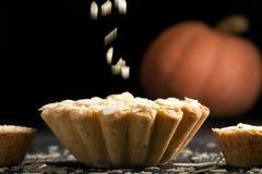 Pumpkin pie with almond slices Stock Photos