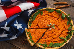 Pumpkin pie with american flag flat lay royalty free stock photography