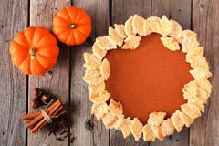 Pumpkin pie with autumn leaf pastry design, overhead scene Royalty Free Stock Photos