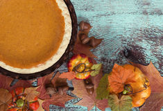Pumpkin pie with autumn leaves and decorations Royalty Free Stock Image