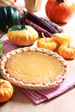 Pumpkin pie with autumn pumpkins and corn Stock Photo