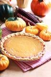 Pumpkin pie with autumn pumpkins and corn Stock Photo