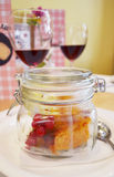 Pumpkin pie with a branch of red currant in the serving bank Stock Photos