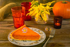 Pumpkin pie and candleholder Royalty Free Stock Photos