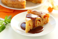 Pumpkin pie with caramel sauce. Stock Photo