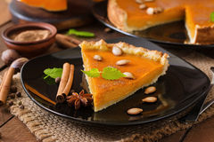 Pumpkin pie with cinnamon and nutmeg Stock Image
