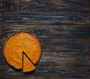 Pumpkin pie on dark brown background Stock Images