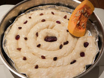 Pumpkin pie dough sprayed with raisins royalty free stock images