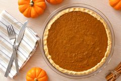 Pumpkin pie downward view on rustic white wood background Stock Images