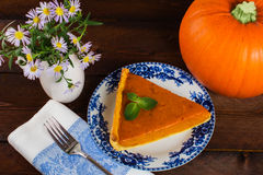 Pumpkin pie and flowers Stock Image