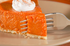 Pumpkin pie with fork stock photography