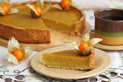 Pumpkin Pie. Fresh homemade pumpkin pie on a plate stock photo
