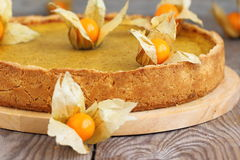Pumpkin Pie. Homemade pumpkin pie on  wooden table Stock Photos