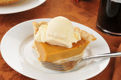 Pumpkin pie with ice cream Stock Images