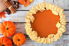 Pumpkin pie with leaf pastry design on rustic white wood Stock Photo
