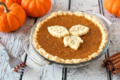 Pumpkin pie with leaf pastry toppings against rustic white wood Royalty Free Stock Images
