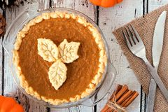 Pumpkin pie with leaf pastry toppings on rustic wood Royalty Free Stock Photo