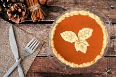 Pumpkin pie with leaf pastry toppings with rustic wood background Royalty Free Stock Photos