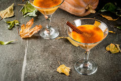 Pumpkin pie margarita. Fall and winter drinks. Thanksgiving and Halloween cocktails. Pumpkin pie margarita with cinnamon stick, on black stone table. Cozy home royalty free stock photography