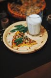 Pumpkin pie and milk. A piece of pumpkin pie and a glass of milk Royalty Free Stock Images