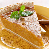 Pumpkin pie with mint garnish. Stock Photos