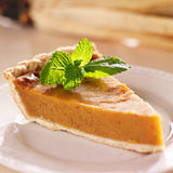 Pumpkin pie with mint garnish closeup Stock Photos
