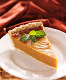 Pumpkin pie with mint garnish Stock Photography
