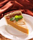 Pumpkin pie with mint garnish Stock Photography