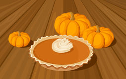 Pumpkin pie and orange pumpkins. Stock Image