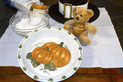 Pumpkin Pie Pan with Teddy and Pilgrim Hat stock photography