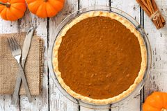 Pumpkin pie in plate, downward table scene Stock Image