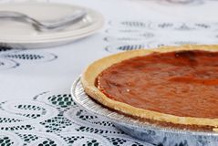 Pumpkin pie with plates Royalty Free Stock Photos