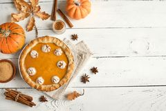 Pumpkin Pie. With whipped cream and cinnamon on white wooden background, top view. Homemade pastry for Thanksgiving traditional royalty free stock photos