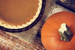Pumpkin pie with a pumpkin Stock Image