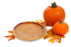 Pumpkin pie with pumpkins and fall leaves on white Royalty Free Stock Images