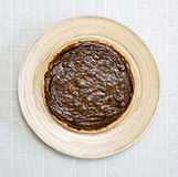 Pumpkin pie on a round plate Stock Image