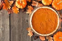 Pumpkin pie, rustic overhead scene on wood. Autumn pumpkin pie, rustic overhead scene on a wood background royalty free stock photography