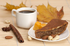 Pumpkin pie served with a cup of coffee Stock Photography