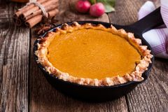 Pumpkin pie in skillet on rural table Stock Photos