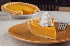 Pumpkin pie slice Stock Images